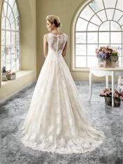 Model 9 - Bijzondere jurk met en kanten bovenlijfje en mooie open kanten rug en tule rok met een opvallende kanten overrok.
